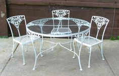 Delicate, elegant... won't blow away in the wind!  Vintage '60s wrought and cast iron patio set!