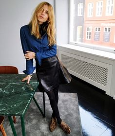 Black turtleneck under denim shirt, leather skirt
