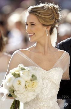 Love the neckline, makeup, hair, and beaming bride