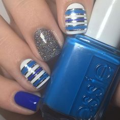 Reposting this just bc 💙💿BLUE AND SILVER STRIPING TAPE NAILS💿💙 ~ these were inspired by @badgirlnails bc I love her mix and match designs!! 😊 ~ PRODUCTS: white: @sally_hansen white on Medium blue: @essiepolish nama-stay the night Darker blue: @essiepolish butler please Dark grey holo: @opi_products my voice is a little norse Striping tape