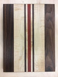 Wood Cutting Board -Walnut Maple Padauk Handcrafted by Dave McGhee Woodshop October, 2016. Bedford, Ohio. An elegant combination of padauk for the red middle stripe, hard maple for the white stripes and walnut for the darker stripes. Joined together with Titebond II, a food safe,