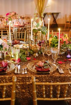 Brides.com: . Taper candles light up a lush and glittering table rich in punches…