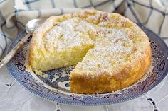 Lemon Rice Polenta cake (gluten free) ~ 2¼ cups unsalted butter, softened, plus extra for greasing 2¼ cups caster (superfine) sugar ~ Grated zest of 4 lemons ~ Juice of 1 lemon 1 tsp. vanilla extract 6 eggs 5½ cups ground almonds 2 cups polenta ½ cup rice flour 2 tsp. baking powder ½ tsp. salt