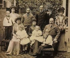 Group picture of Edward VII, Queen Alexandra and family at Sandringham. Seated, Mary, Duchess of York, with Prince Edward of York (later Duke of Windsor), Queen Alexandra (with Prince Henry, later Duke of Gloucester) and King Edward VII. The Duke of York, later King George V, is standing behind his mother and wife.