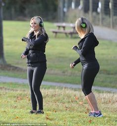 Fitness first: Standing alongside her pal, Kate paraded her shapely pins in a pair full-length leggings which she teamed with a black jumper as she posed for the camera