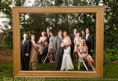 gold photo frame for wedding. you could keep it in close to the camera and get a normal size frame instead of this ginormous one...