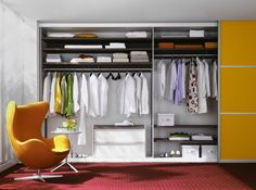 "We like to call this modern design idea, ""orange juice."" It is a modern sliding door closet that uses the bright color of orange to create an accent in a bedroom's interior design."