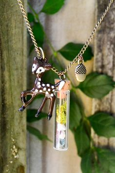 The whimsical and ingenious terrarium necklaces of Knees on Leaves.