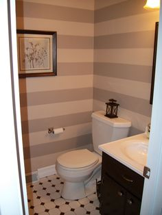 small guest bathroom. Love the striped wall!!