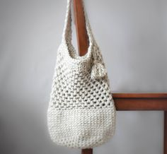 With the arrival of spring, I just can't wait to browse aroundthe farmers' markets and simply be OUTSIDE! This crochet bag is what I've made (while it was snowing) with dreams of toting it around in the warmer months. I wanted to make it fairly sturdy, and didn't want overly large holes for things to fall through. This bag has astrong bottom and a hefty handle. I'm thinking that I can even use it as a book bag, which I desperately needed the last time I took my girl to...