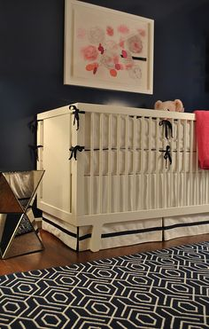 Navy and Pink Nursery Navy…it's not just for boys anymore! How amazing is this pink and navy nursery? The crisp, white crib and bedding really pop against the navy and wood floors. Navy Girl Nursery, White Nursery, Nursery Room, Coral Nursery, Nursery Decor, Navy Walls, Nursery Inspiration, Nursery Ideas, Project Nursery