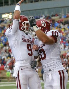 Oklahoma's Trevor Knight (9) and Blake Bell (10) celebrate Bell's touchdown reception during an NCAA college football game between the University of Oklahoma (OU) Sooners and the Tulsa Golden Hurricane (TU) at H.A. Chapman Stadium in Tulsa, Okla., on Saturday, Sept. 6, 2014. Photo by Chris Landsberger, The Oklahoman
