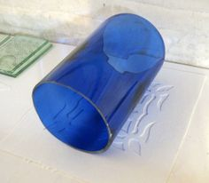 Fusing bottle glass with kiln carving (A nickel for a bottle vs. $6-10 for a sq. ft. of glass)