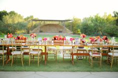 Bright & colorful flower arrangements on long reception tables | Priscila Valentina Photography