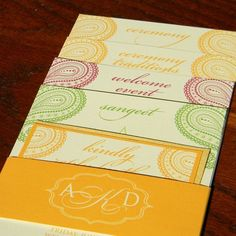 Tiered wedding invitation by http://paperandhome.com | Champagne shimmer paper wrapped in a belly band with custom monogram.