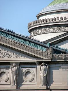 1893 Beaux Arts style rooftop    Museum of Science and Industry  Chicago, Illinois, USA    The Chicago Museum of Science and Industry is housed in what was originally the Palace of Fine Arts building from the 1893 Chicago World's Fair (World's Columbian Exposition). This is a detail shot of part of the roofline and dome showing the intricate trim and decorative statuary.