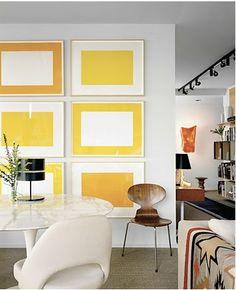 Add Art and Accessories. Color blocking gallery wall. Interior Designer: Joe D'Urso.