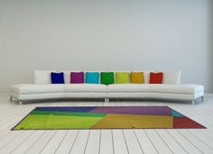 We don't expect you to rush into this décor trend and transform your home overnight. Like most trends, it's expedient to start slowly and have a trial run first. Start by colour blocking with accessories – a stack of brightly coloured throw cushions and carpet in an otherwise plain room will keep you on trend while immediately livening up your sofa or bed.