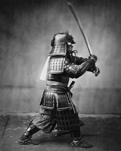 Armoured Japanese Samurai with sword and dagger, ca. 1860.