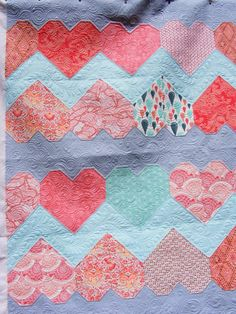 Hearts quilt for Joy by Tia Curtis Quilts.  The Paper Hearts design is by Tula Pink.  Quilting by TIA CURTIS QUILTS