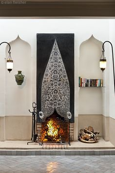 Sculpted tadelakt babouche style fireplace from Riad Farnatchi