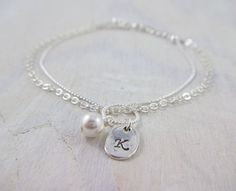 Personalized Initial Pearl Bracelet, Swarovski Charm bracelet, Bridesmaid gift, Handmade Swarovski bracelet, Wedding jewelry, gift for mom, maid of honor, Gifts for her Bracelet details:  * please indicate initial desired at checkout * white genuine Swarovski pearl (ivory/cream pearl also available) * 10mm silver twist rope circle connector * silver plated loop chain and solid chain * Loop chain is 1/2 inch longer than the solid chain to allow the bracelet fall on the wrist as depicted in…