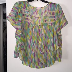 Old Navy dolman sleeve top size XXL  Dolman sleeve top just in time for your spring wardrobe update . Made of polyester so it won't shrink or wrinkle in the wash!  Can be worn tied at the neck or untied!  Worn only a couple of times!  In excellent condition!! Old Navy Tops Blouses
