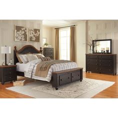 Signature Design by Ashley Maxington Black/Reddish Brown Storage Bed