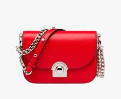 Prada Arcade calf leather shoulder bag Sliding metal shoulder strap with studded leather shoulder pad Steel hardware Logo embossed on clasp Snap-lock clasp on flap Two inside pockets, including one with zipper closure Nappa leather lining