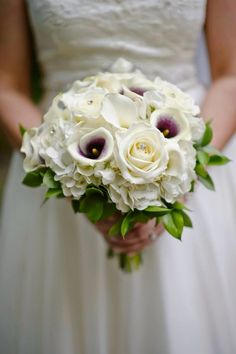 Purple and white Cala Lillie's, with white Roses and Hydrangea by All Grand Events, East Lansing, MI