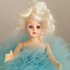 Vintage doll with aqua blue net skirt.