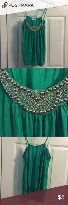 Candies Turquoise Studded Cami Just a bit wrinkly. Just needs to be ironed. Super cute. Kinda like a crop top. Please don't hesitate to ask any questions you have. Don't like my price? Make an offer. 30% OFF ANY BUNDLE Candie's Tops Camisoles