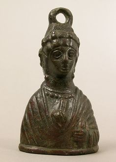 Weight in the Shape of a Byzantine Empress. 5th century, Byzantine, Copper alloy. Portraits busts of Byzantine empresses were used for weights, thereby encouraging the public's belief in the state's ability to ensure fair and prosperous trade.