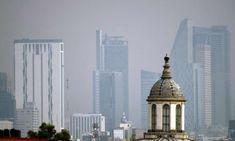 Scientists say breathing the air in Mexico City is like smoking between a quarter- and a half-pack of cigarettes a day Grey Clouds, Central City, Life Goes On, Air Pollution, Mexico City, Scientists, Seattle Skyline, Empire State Building, Smoking