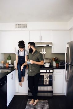 Couple in Kitchen Wearing Overalls and Olive Shirt for a Cute Comfy Look