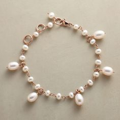 """ROSIE'S PEARL BRACELET�--�Cultured freshwater pearls reflect their links' rosy warmth, a glowing play of iridescence by Eric Van Peterson. Handmade in London of 18kt rose gold plate on sterling silver. Lobster clasp. 7-1/4"""" X 8-1/4""""L."""