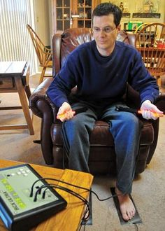 Matt Hinshaw/The Daily CourierJamey Mauk uses a device to treat his Lyme disease Friday afternoon at his Prescott home. Mauk has had Lyme disease for the past eight years and was misdiagnosed multiple times.