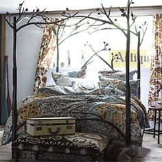VERY COOL...THE BED IS BOUND TO ATTRACT WOODLAND FAIRIES AND DEER...MAYB A HOBBIT OR 2? HAHAHA