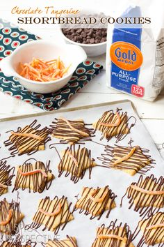 Shortbread Cookies with Chocolate Drizzle and Candied Tangerine Rind