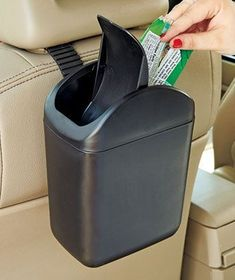 car trash can. I used to have one of these when I was a kid and it was a big plush lady bug that hung from the back of the head rest Trash Can For Car, Car Trash, Car Cleaning, Cleaning Hacks, Spring Cleaning, Accessoires Iphone, Car Gadgets, Car Storage, Car Hacks
