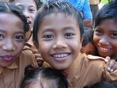 Rotarians in Australia give AUD130 a year to children in Bali, which provides school uniforms, shoes and socks, and a schoolbag filled with books and supplies for each child. Remaining funds helped build a local library.
