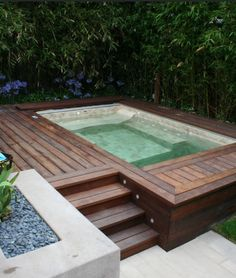 Outdoor Jacuzzi: we wouldn't look for one (or install it.) but I love this treatment for an existing jacuzzi/small pool. Small Backyard Pools, Small Pools, Backyard Landscaping, Backyard Ideas, Indoor Pools, Landscaping Ideas, Small Backyards, Hot Tub Backyard, Indoor Swimming