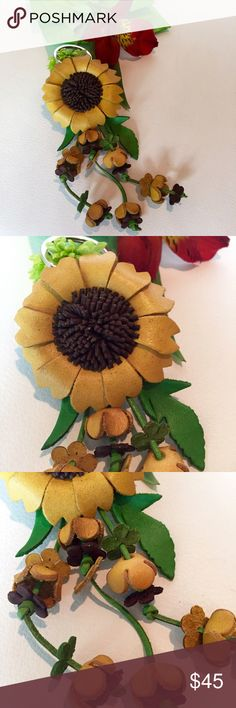 Florence Italy leather sunflower keyring NWT Florence Italy handmade leather sunflower keyring NWT. Come in original gift packaging from MY WALIT Italian Accessories Key & Card Holders