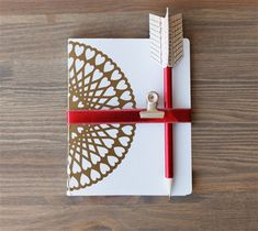 DIY Doily Notebook & Arrow Pencil-create it easily with your Cricut Explore Air. This project is available exclusively with the Cricut Explore Air Gold machine at JoAnn.