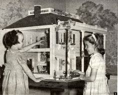 My Vintage Dollhouses: Little girls and their dollhouses.....Plans for this huge dollhouse are still sold on eBay. These little girls from the early 1950's look happy enough to be playing with this house, whether it was their house or just for the photo.