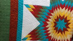 Lone Star quilt  This absolutely beautiful.  I don't have the patience to quilt pieces this small.  I love th colors and could work with that.