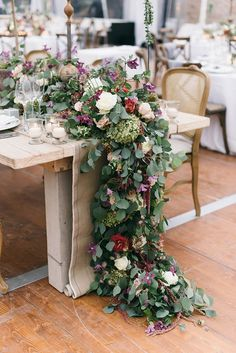 floral table runners - photo by Lisa Poggi http://ruffledblog.com/romantic-black-tie-wedding-in-tuscany