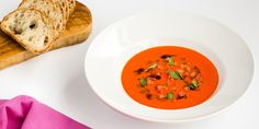 This spicy tomato soup recipe by Michael Caines is served with a vibrant basil oil for a delightfully aromatic finish.