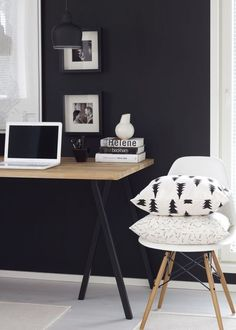 black and white workspace with a black wall