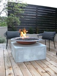 black wooden fence and fire pit